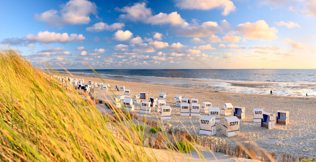 Sylt, Schleswig-Holstein, Germany - Strand Westerland near Rantum with typical roofed beach chair.